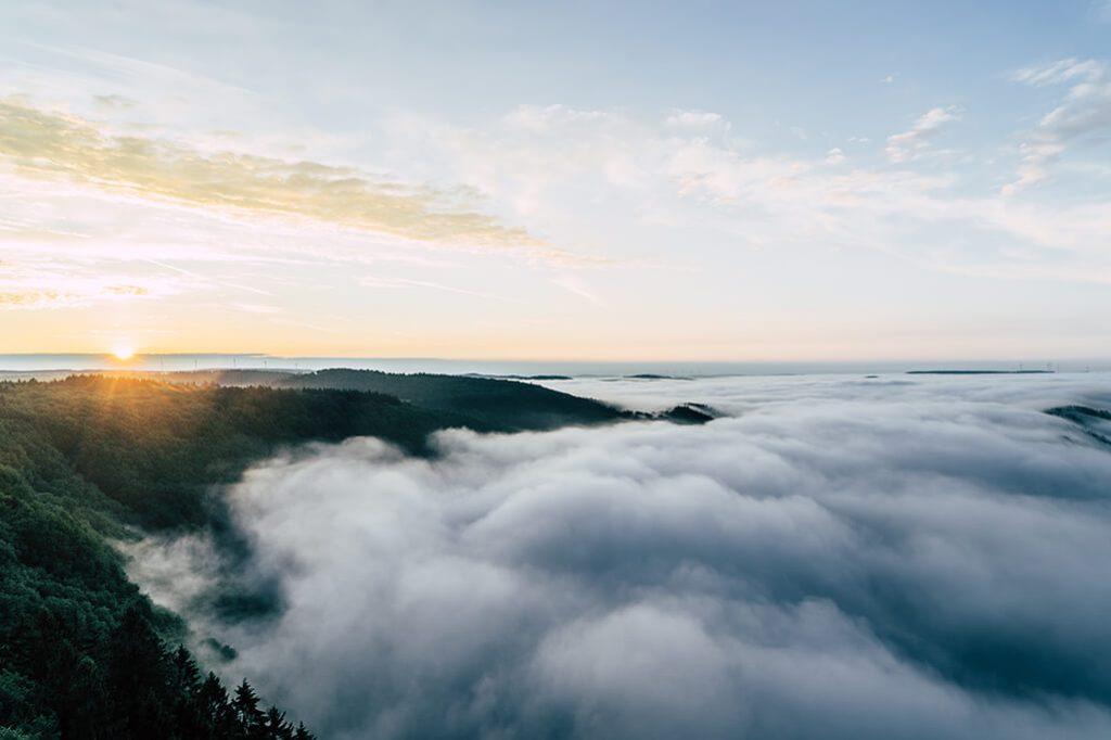 Sonnenaufgang ueber der Saarschleife